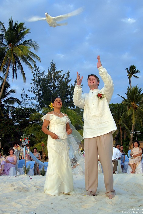 of white doves following their wedding ceremony on Boracay Philippines